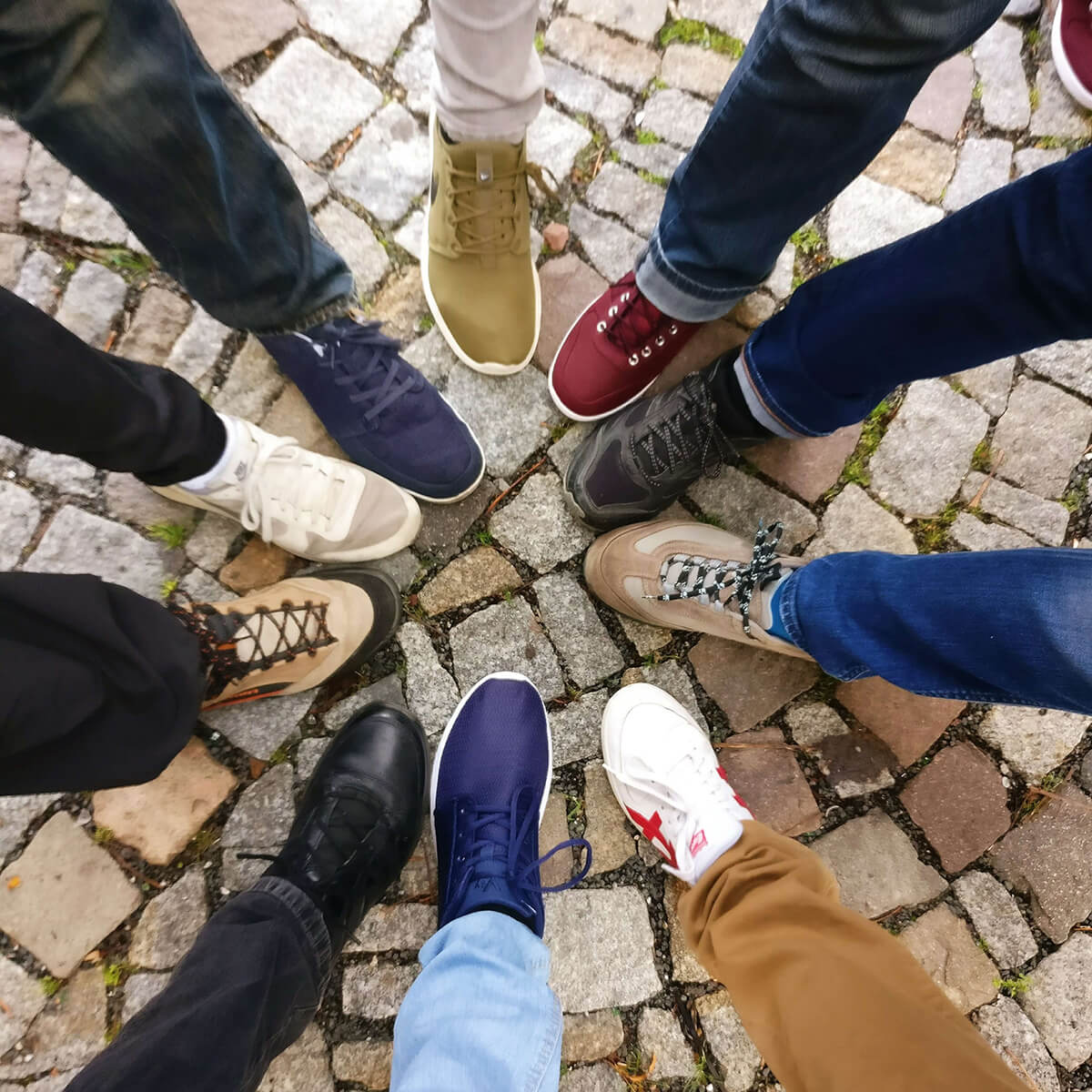 circle of people with their feet together