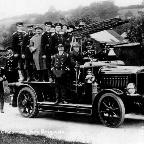 photo of people standing in old fire engine