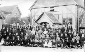 Unknown group of men, boys, girls and women outside what appears to be a school. Around 1910. Photo donated by Peter Brown. [image code: h7-42-04]