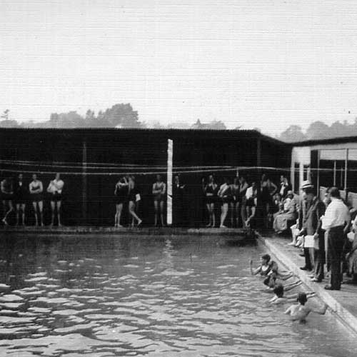 people stood next to swimming pool