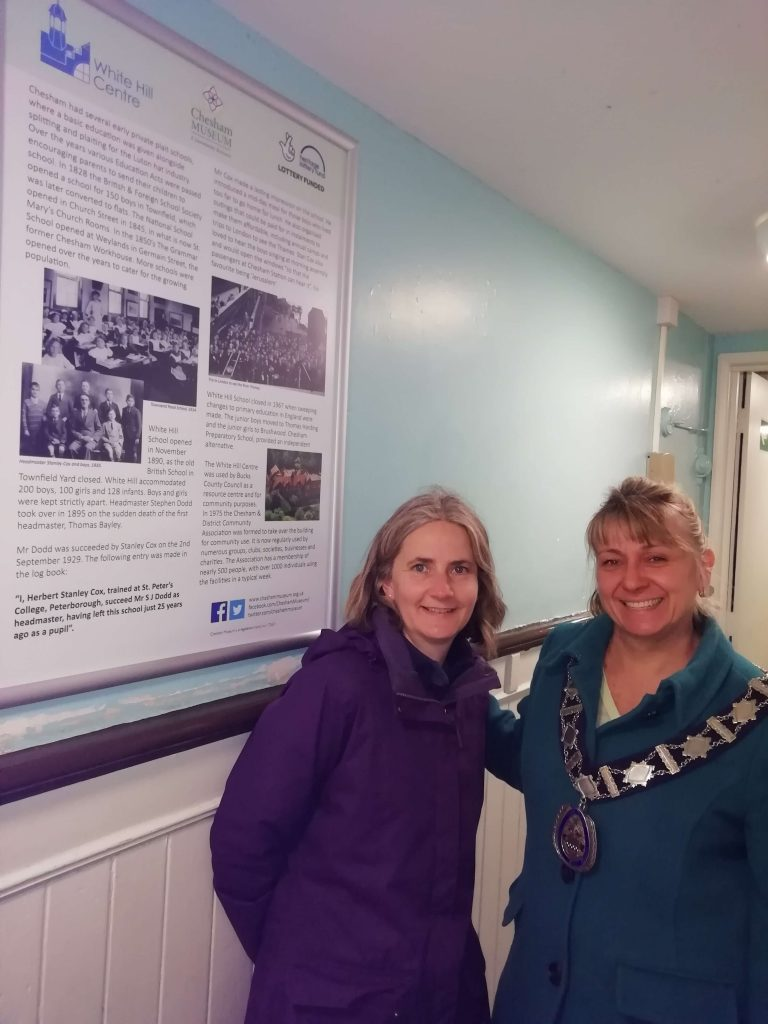 Chesham mayor and Chesham Museum trustee next to the museum panel in White Hill
