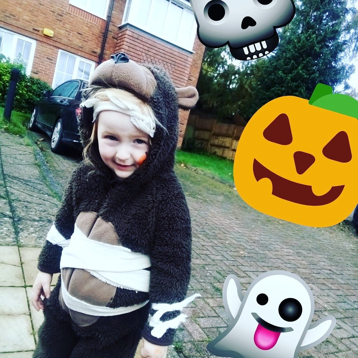 Lucy dresses as a bear with pumpkin and ghost stickers in the image