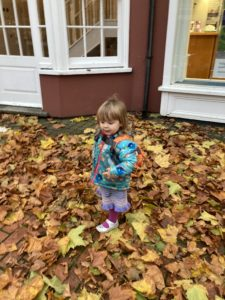 Jessica walking in the leaves during the Museum trail