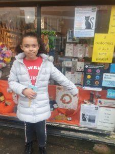 Monet finds the letter K in shop window
