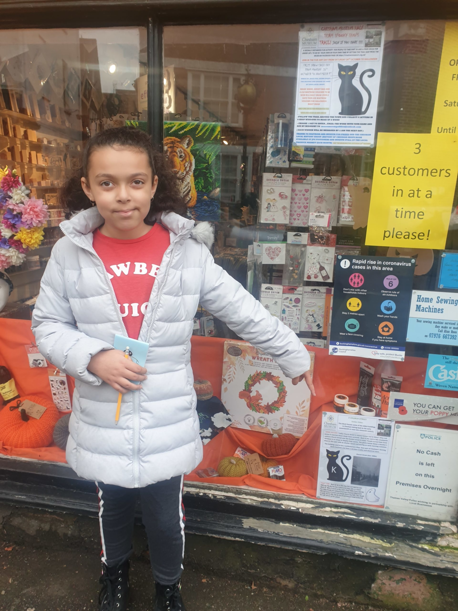 Monet finds the letter K in shop window