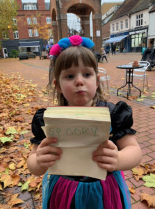 Molly holding up the word Spooky