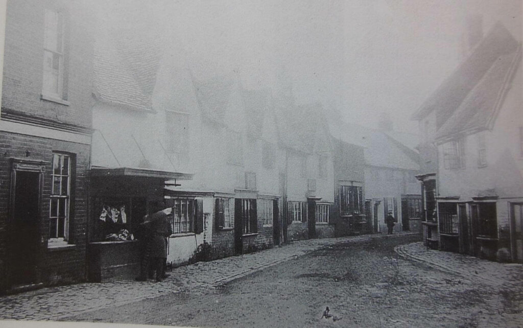 Street in Chesham with butchers shop front visible