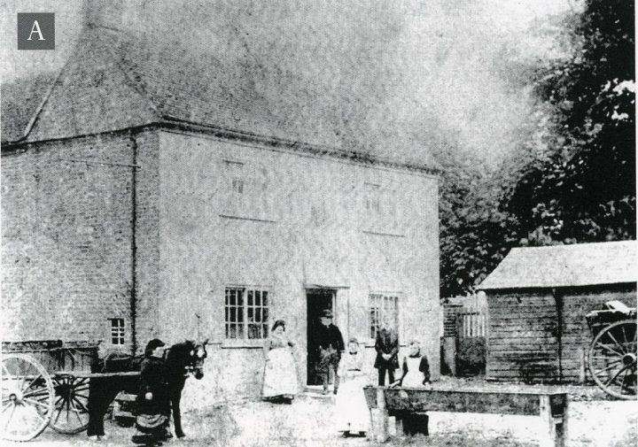 People standing at entrance to the building that is now Jolly Sportsman - garden is still there with people and horse and cart nearby
