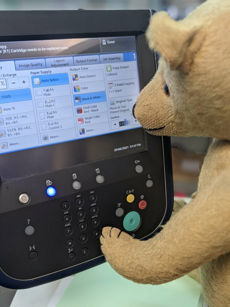 Teddy is operating the cop machine controls