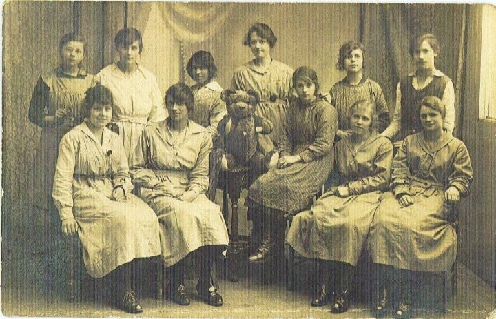 Photo of factory staff some seated some standing