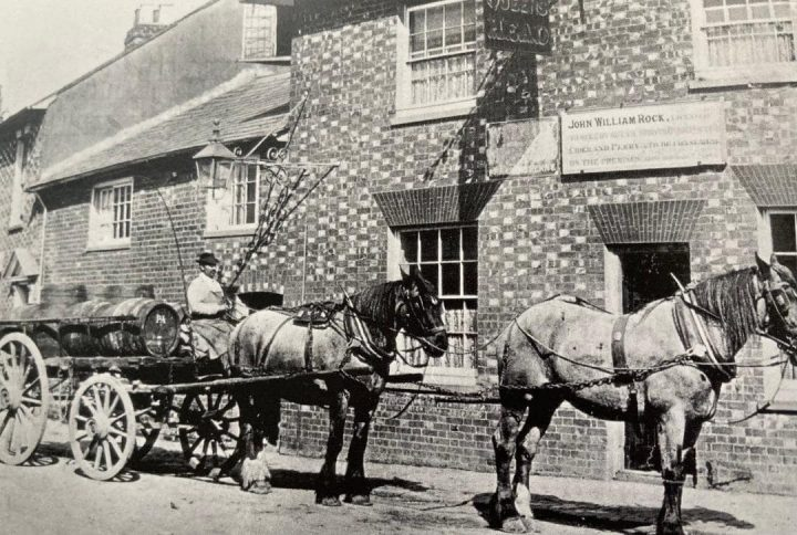 Drayman on horse and cart passing The Queen's Head